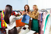 Girls with purchase — Stock Photo