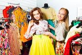 Two women choosing   skirt — Stock Photo