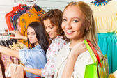 Woman and  friends in shop — Stockfoto