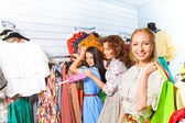 Woman and  friends in shop — Stock Photo