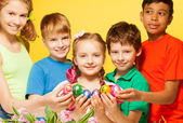 Kids  hold Eastern eggs — Stock Photo