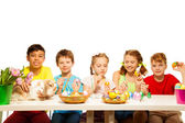 Kids painting Eastern eggs — Stock Photo