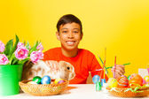 Boy paints Easter eggs — Stock Photo