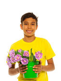 Boy holding tulips — Stock Photo