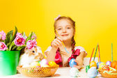 Girl colouring Eastern eggs — Stock Photo