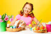 Girl   with Easter eggs and rabbit — Stock Photo