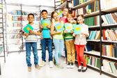 Schoolchildren   in library — Stock Photo