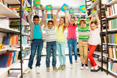 Six children in library — Stock Photo