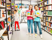 Friends in  library — Stock Photo