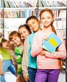Kids  inside library — Stock Photo
