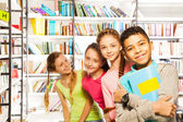 Four  kids   with books — Stock Photo
