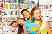 Four children  inside library — Stock Photo