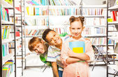 Three children   with books — Stock Photo