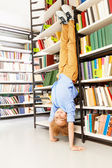 Boy standing  in library — Stock Photo