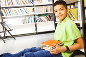 Pupil with pile of books — Photo