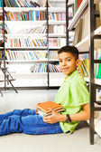 Pupil with pile of books — Stock Photo