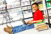 Boy with books and laptop — Stock Photo