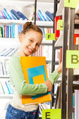 Girl searching books — Stock Photo