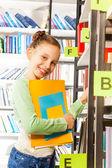 Girl searching books — Stockfoto