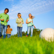 Happy family plays football in summer — Stock Photo #48544667