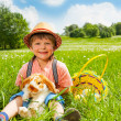 Small boy wearing hat and hugging rabbit — Stock Photo #48546217