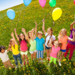 View from top to standing kids with balloons — Stock Photo #48546745