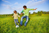 Father and boy playing football together in park — Stock Photo