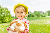 Happy blond girl with yellow flowers circlet — Stock Photo