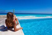 Gorgeous woman sunbathing near swimming pool — Stock Photo