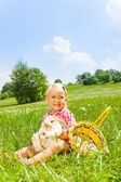 Happy small girl cuddles rabbit in green meadow — Stock Photo