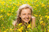 Portrait of beautiful girl in the green grass — Stock Photo