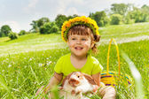 Smiling girl wearing flowers circlet and rabbit — Stock Photo