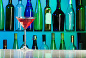 Glass with pink liquid stands on table of bar — Stock Photo