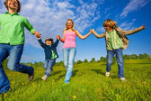 Positive parents walking with boys in park — Stock Photo