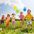 Running kids in green field during summer — Stock Photo #48560279