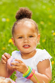 Portrait of cute curly girl with Eastern egg — Stock Photo