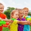 Постер, плакат: Kids with water guns