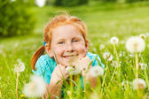 Girl lays on a grass — Stock Photo