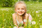 Girl on a grass — Stock Photo