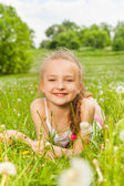 Girl laying on a meadow — Stock Photo