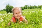 Girl laying on grass — Stock Photo