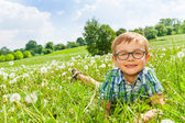 Boy laying on a grass — Stock Photo