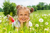 Girl laying on a grass — Stock Photo