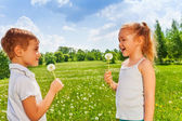 Kids with dandelions — Stock Photo