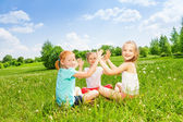 Kids playing on a grass — Stock Photo