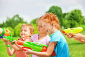 Kids with water guns — Stock Photo