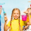 Girls painters against wall — Stock Photo #49944975