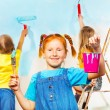 Girls painters against wall — Stock Photo #49944985