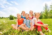 Kids sitting on a grass — Stock Photo