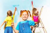 Girls painters against wall — Stock Photo